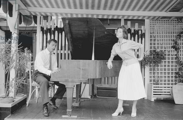 Yves Montand and Francoise Arnoul at the piano, Italy, 1955 (b/w photo)