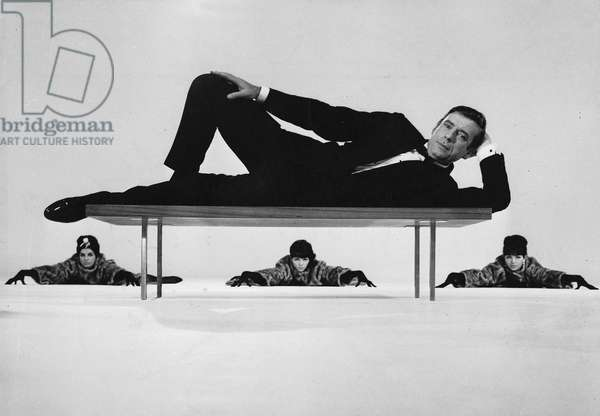 Yves Montand lying on a table