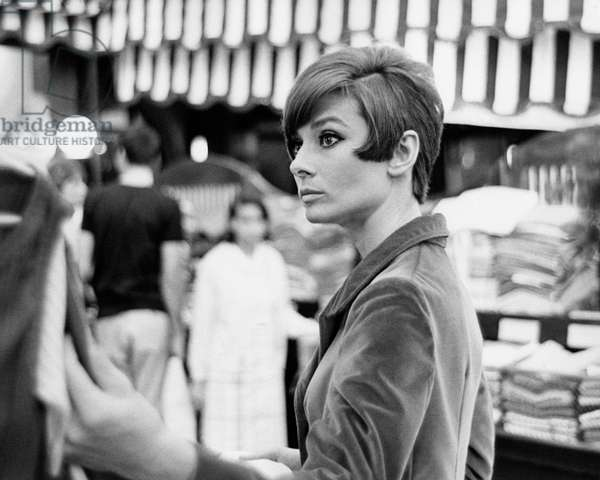 Audrey Hepburn into a fabric and clothes store, 1966 (b/w photo)