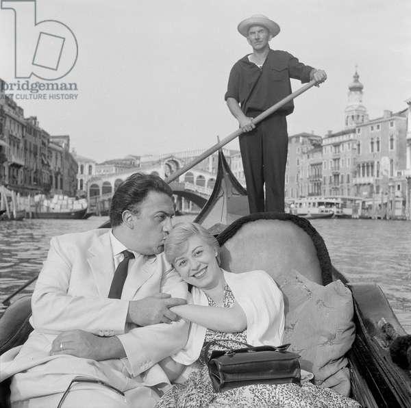 Federico Fellini and Giulietta Masina in a gondola, Italy, 1955 (b/w photo)