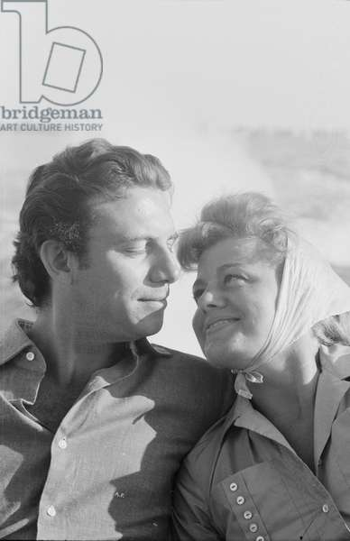 Shelley Winters and Anthony Franciosa in motorboat, Italy, 1958 (b/w photo)