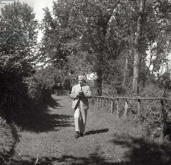 William Faulkner walking (b/w photo)