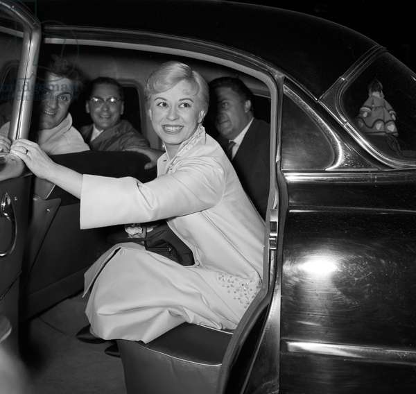 Giulietta Masina, Federico Fellini and Riccardo Fellini in a car, Italy, 1957 (b/w photo)