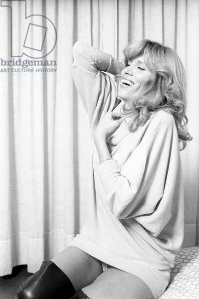 Amanda Lear in a mischievous pose