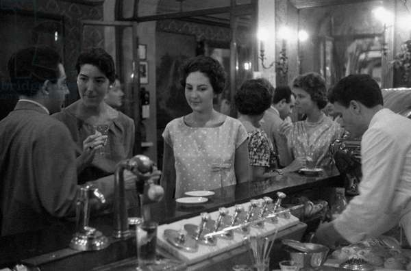 A girl standing at the bar of the Antico CaffèGreco, Rome, Italy
