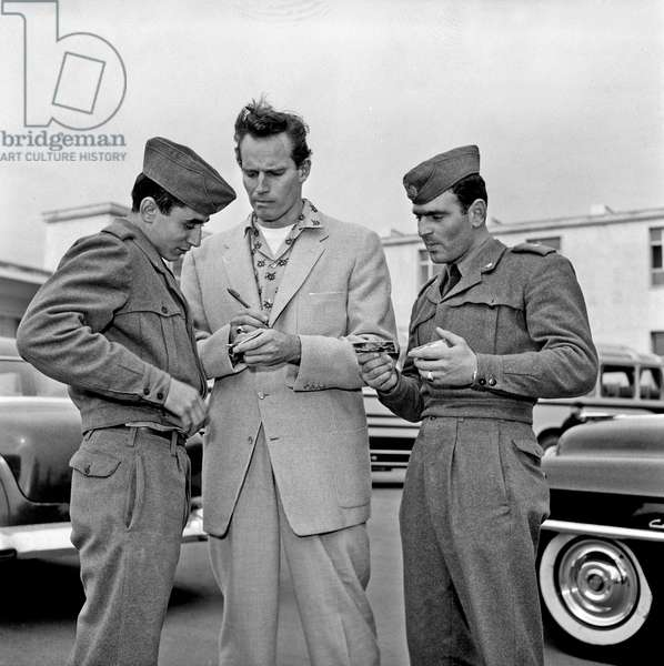 Charlton Heston signing autographs to two soldiers, Ciampino, Italy, 1958 (b/w photo)