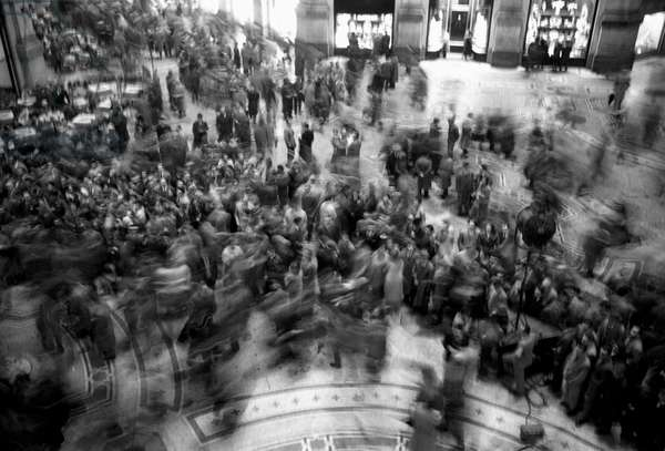 The long time exposure of this picture emphasizes the movement of film crew members and curious bystanders; this picture was shot during the shooting of the movie