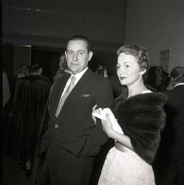 Olivia de Havilland and Pierre Galante in the café of the foyer of Eliseo Theatre, Italy, 1955 (b/w photo)