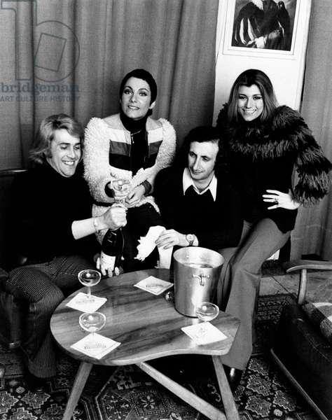 Marina Occhiena, Angela Brambati, Angelo Sotgiu and Franco Gatti with a bottle of champagne