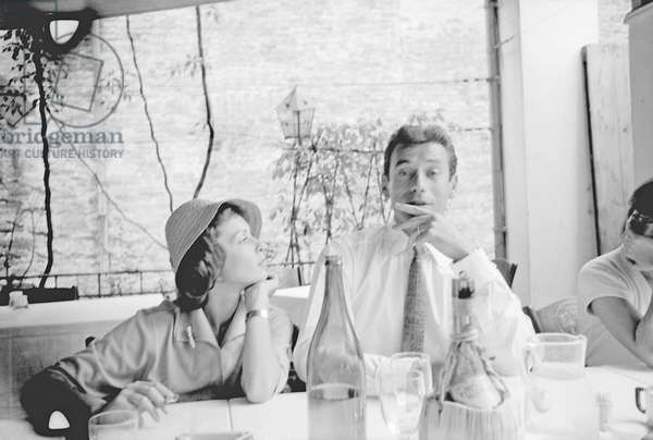 Yves Montand and Francoise Arnoul at the restaurant, Italy, 1955 (b/w photo)