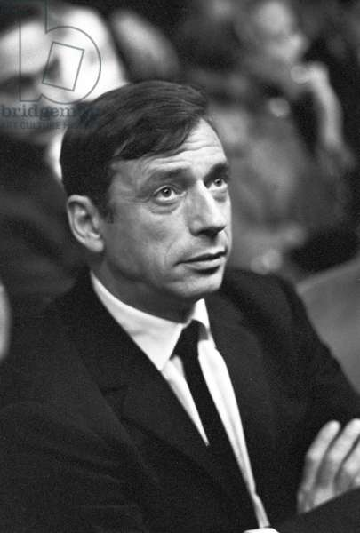 Yves Montand attending the concert of Edith Piaf, Paris, France, 1962 (b/w photo)
