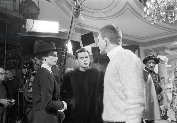 Capucine and Robert Wagner speaking with Blake Edwards, 1963 (b/w photo)
