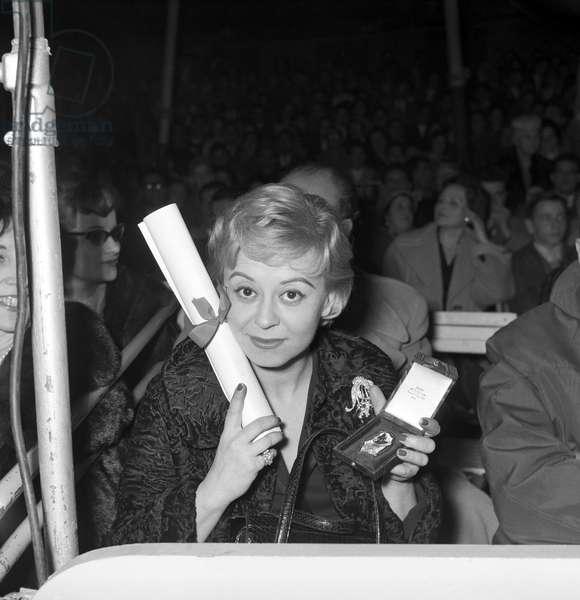 Giulietta Masina attending the Clown d'oro ceremony at the Orfei Circus, Italy, 1959 (b/w photo)