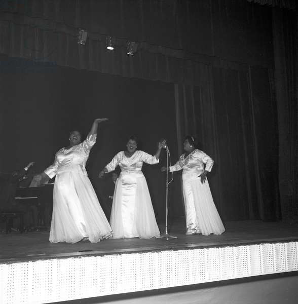 The Peters Sisters singing at a theatre (b/w photo)