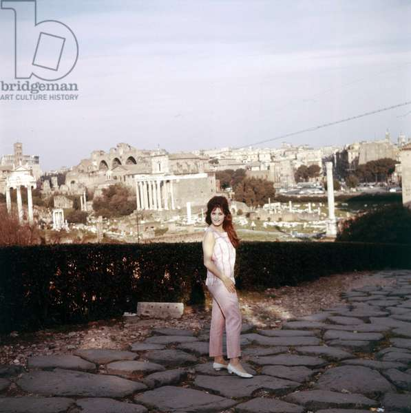 Dalida smiling on a Roman paved road, Rome, Italy