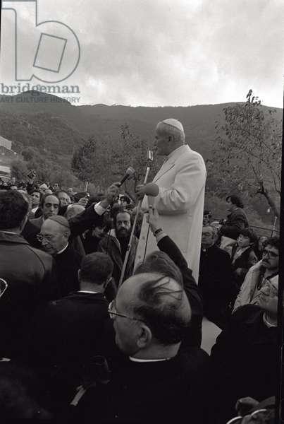 Pope John Paul II is speaking to a group of people