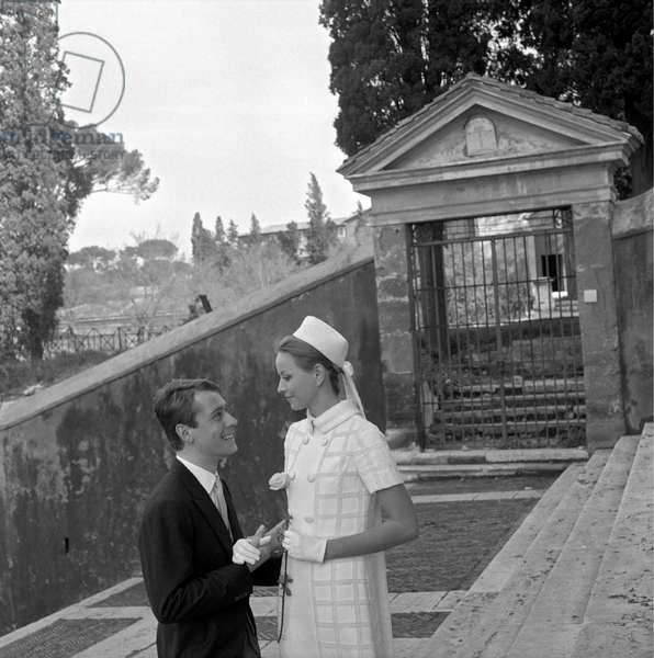 A young married couple smiling in the day of their wedding, Italy