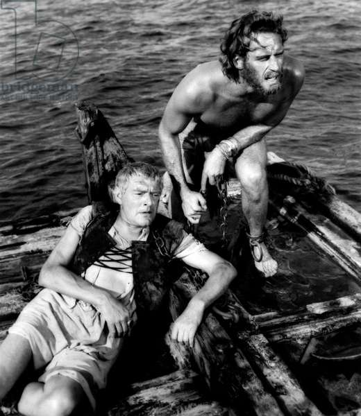 Charlton Heston and Jack Hawkins on a raft
