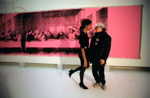 Andy Warhol watching a model