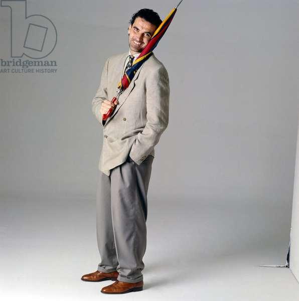 Massimo Troisi holding an umbrella, Italy