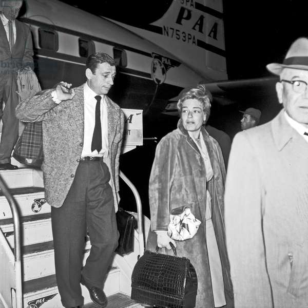 Yves Montand and Simone Signoret arriving at Ciampino airport, Ciampino, Italy, 1956 (b/w photo)