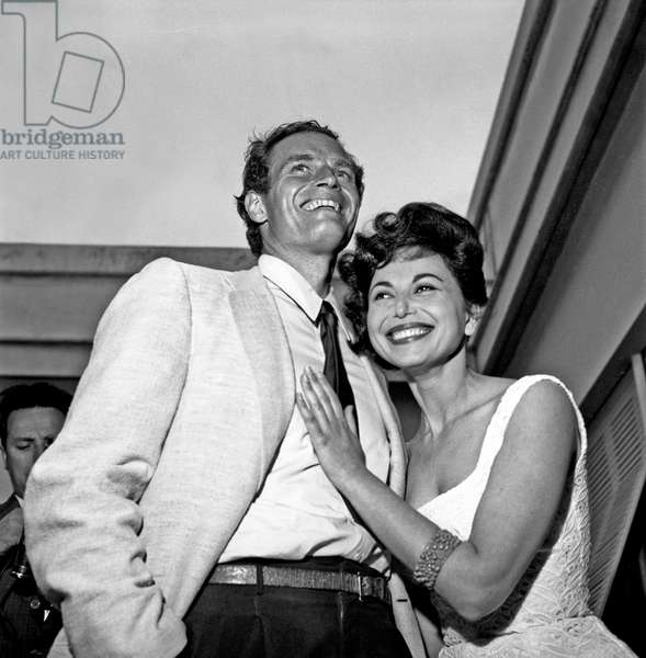Charlton Heston and Lydia Clarke at the cocktail in Cinecittà, Italy, 1958 (b/w photo)
