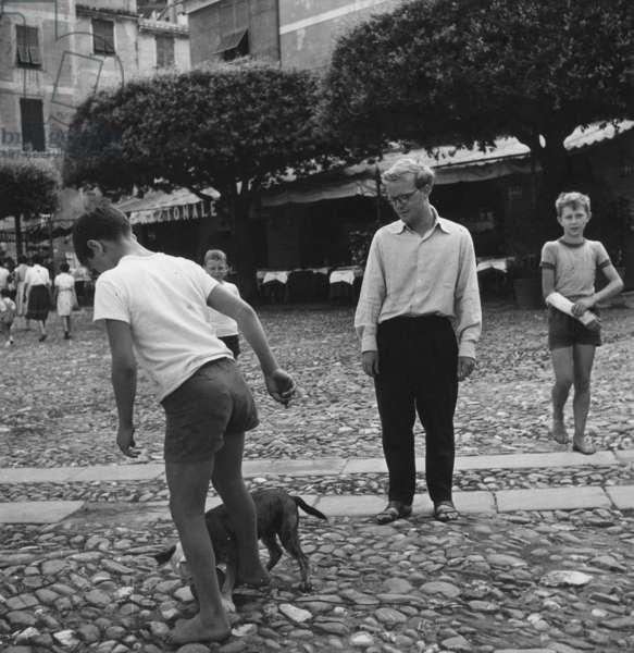 Truman Capote watching a boy, Portofino, Italy