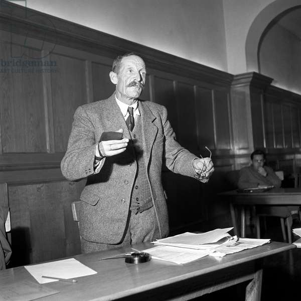 A citizen of Trentino-Alto Adige/Sudtirol attending a meeting at a polling station during the regional election, Italy, November 1952 (b/w photo)