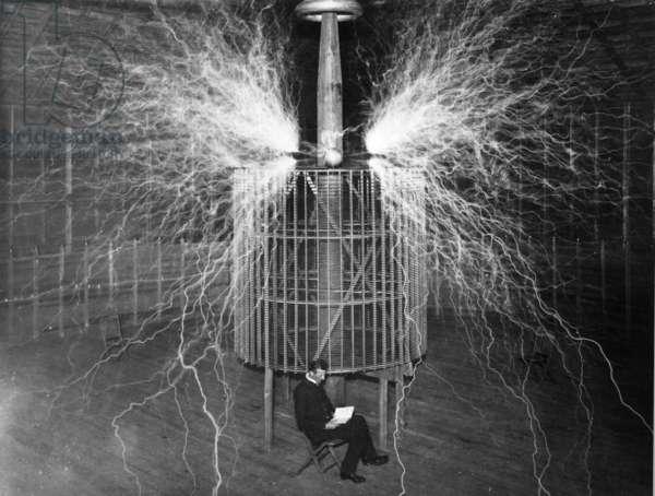 Nikola Tesla in his laboratory, United States, 1909 (b/w photo)
