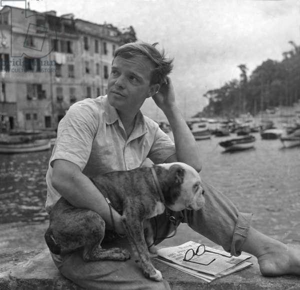 Truman Capote with his dog, Portofino, Italy