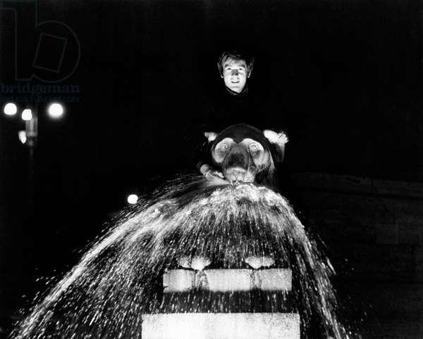 Enzo Cerusico rides a lion shaped fountain