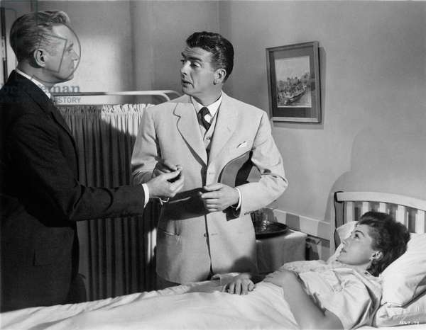 Victor Mature in hospital standing beside Esther Williams in a scene from the movie 'Million Dollar Mermaid', 1952 (b/w photo)
