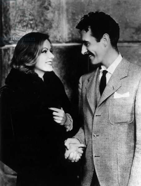 Greta Garbo shaking hands with John Gilbert