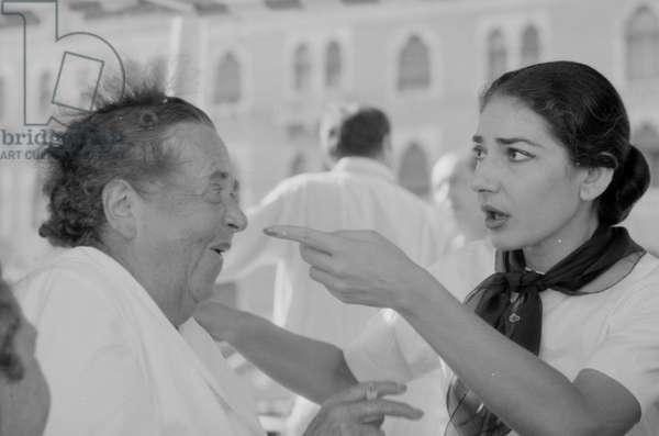 Maria Callas joking with Elsa Maxwell, Italy, 1957 (b/w photo)