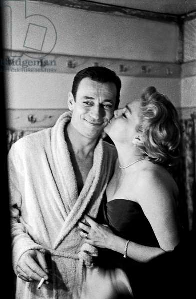Simone Signoret kissing Yves Montand in the dressing room, Italy, 1959 (b/w photo)
