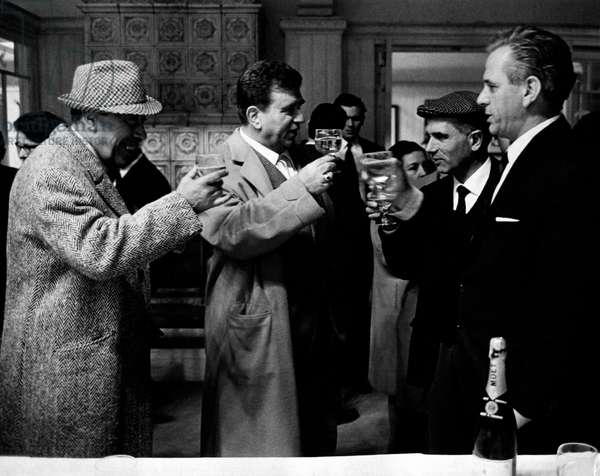 Gino Cervi drinking a toast with Fernandel, 1950s (b/w photo)