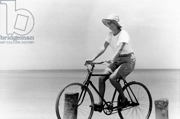 French actress Catherine Deneuve riding a bicycle by the sea on the set of JeanPaulRappeneau's film 'Call Me Savage' in Caracas, Venezuela in 1975