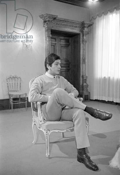 Valentino at his atelier, 1963 (b/w photo)