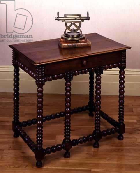 Side table with drawers, French, 16th-17th century (walnut wood) and a Surveying instrument, English, 18th century (brass)