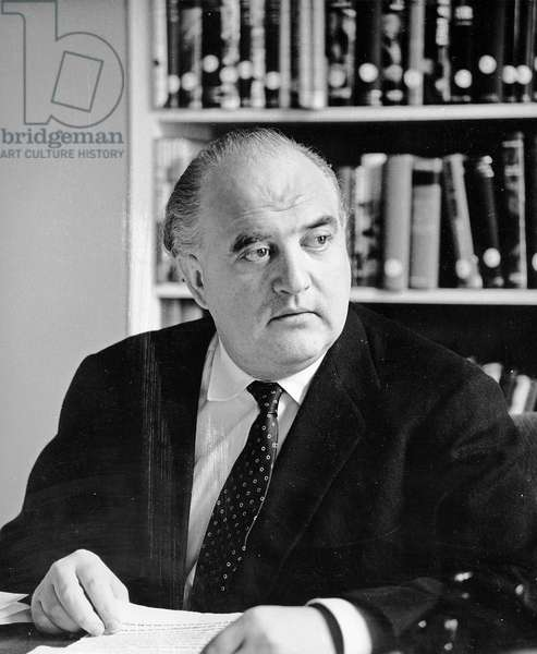 Gerge Weidenfeld at his desk at the New Bond St offices, 1963 (photo)