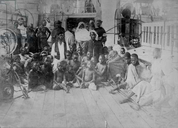 A group of slaves, possibly on board HMS London, 1880 (albumen print)