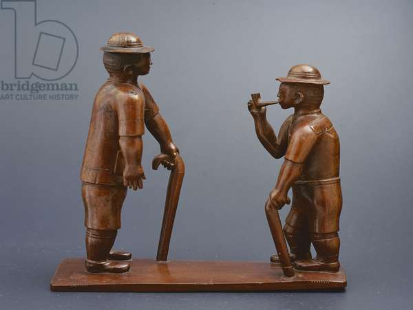 Two European figures standing on a base, one with a stick and the other holding a pipe, Bahr el Ghazal, East Africa, c.1900 (wood)