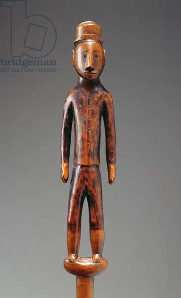Staff with a carved figure (wood)