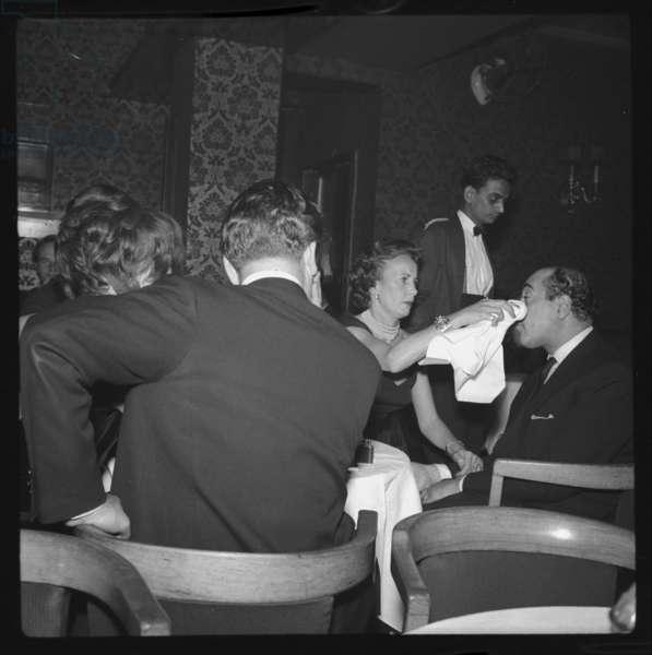 Princess Lilian of Sweden attending to the Maharaja of Bundi, Stork Room, London, UK, 1955 (b/w photo)