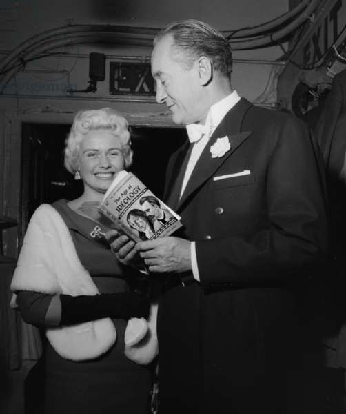 George Sanders expounding Schopenhauer to actress Lili Bergkrona, 1958 (b/w photo)