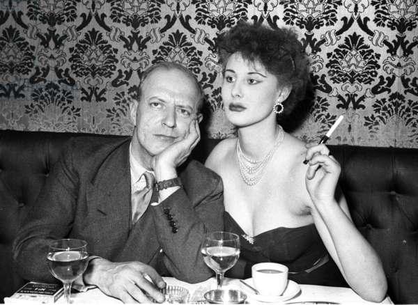 Showgirl and boyfriend, Stork Room, London, UK, 1954 (b/w photo)