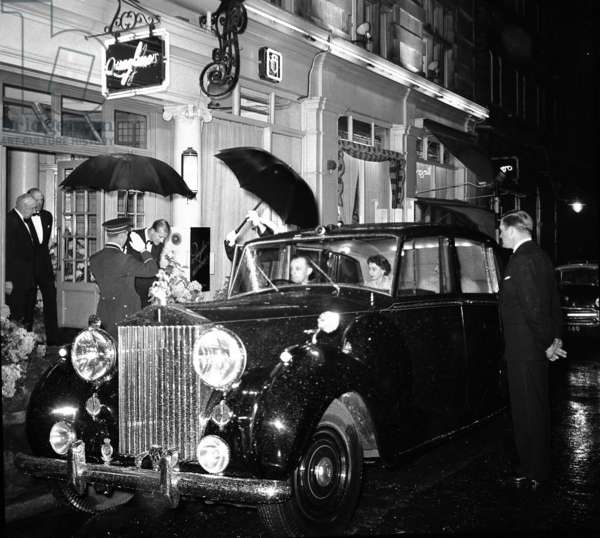 Queen and Duke leaving a private dinner at Quaglino's Restaurant, attended by Police Commander Kelly (b/w photo)