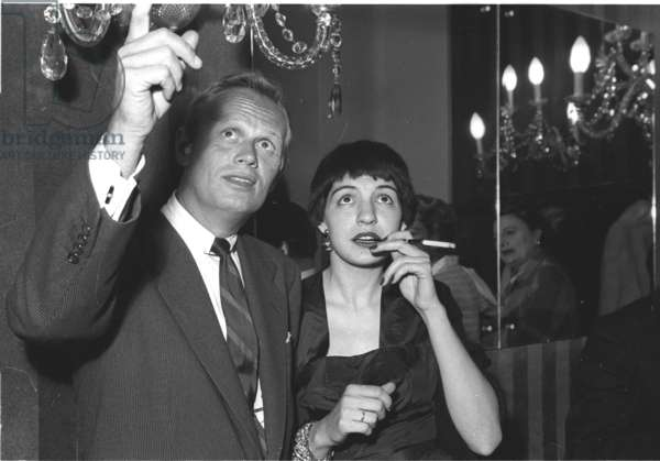 Richard Widmark and American Journalist Sheila Cole, Stork Room, London, UK, 1954 (b/w photo)