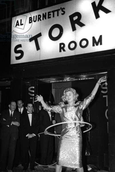 Gina Egan, Maharani of Cooch Behar and Hula Hoop, Stork Room, London, UK, 1956 (b/w photo)