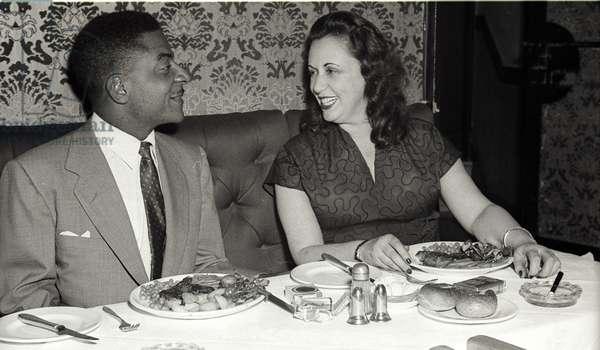 Teddy Wilson and Baroness Pannonica 'Nica' de Koenigswarter, Stork Room, London, UK, 1955 (b/w photo)